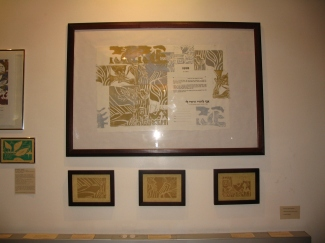 On exhibit linoleum prints and Ketubbahs made with artwork.
