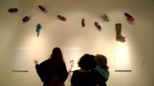 If Shoes Could Talk Exhibit welcoming viewers to interact with the work on the three canvases.